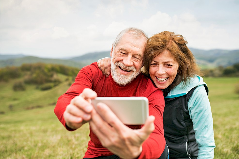 Woman and man taking selfie outside on trip