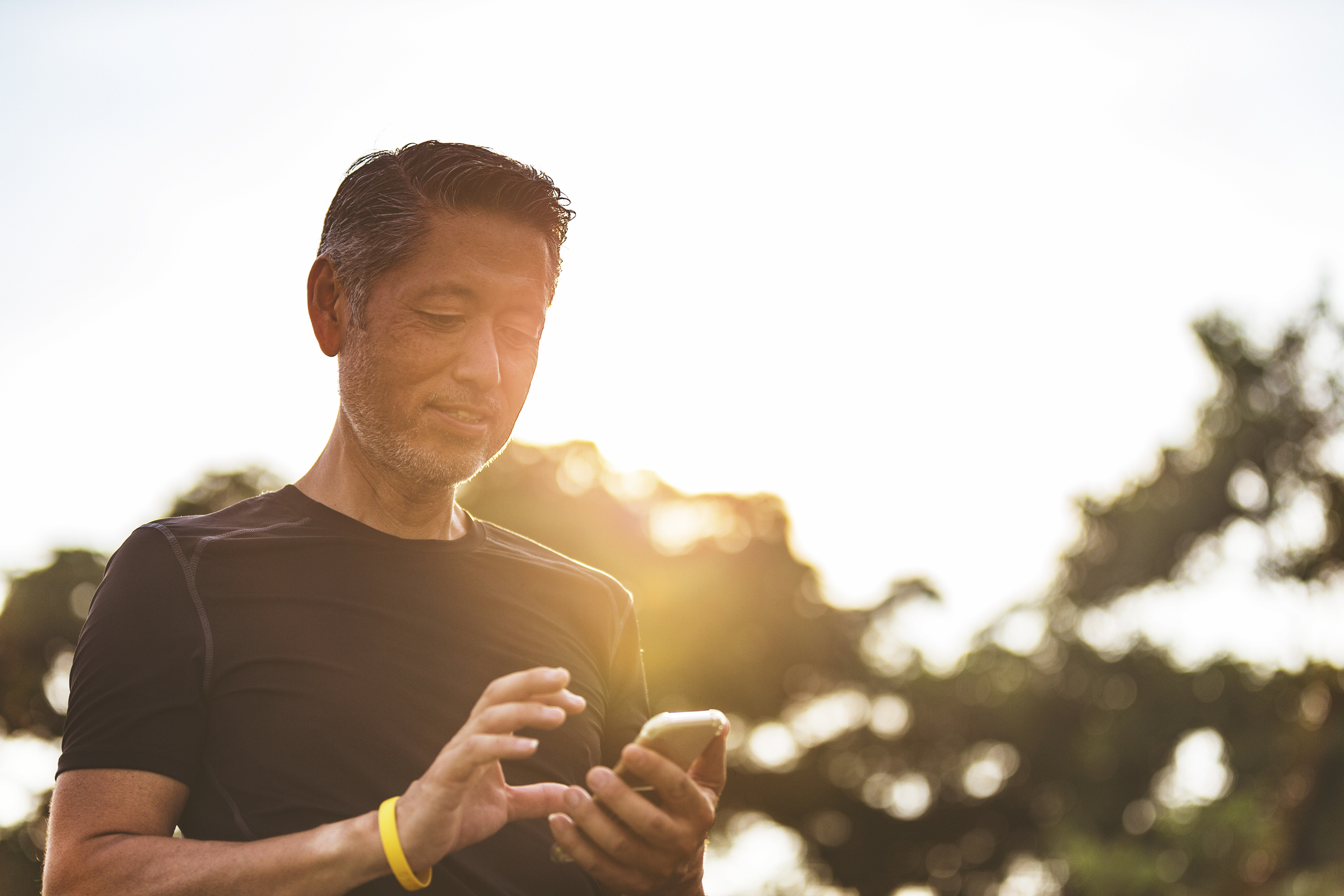 Man outdoors holding phone